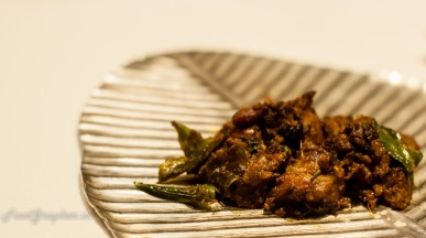 Vaigai Kari sukka Succulent lamb morsels gently cooked in fragrant spices, a typial comfort food of Madurai