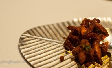 Kori Kempu Shredded chicken marinated with chillies and spices fried and tossed in yoghurt
